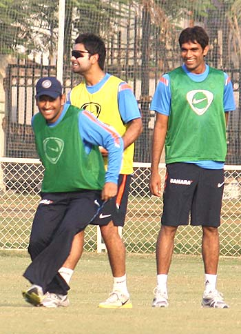 Mahendra Singh Dhoni (left) with team-mates