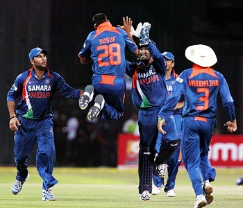 Yusuf Pathan celebrates with team-mates