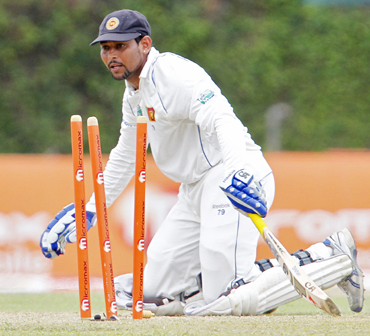 Sri Lanka's Tillakaratne Dilshan watches as he is run out