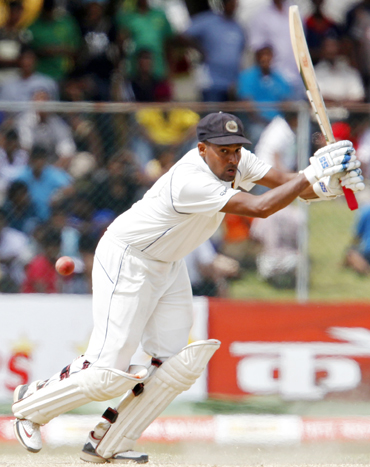 Sri Lanka's Thilan Samaraweera plays a shot during the fourth day of their third and final test cricket match against India in Colombo