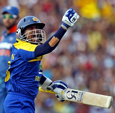 Tillakaratne Dilshan celebrates scoring his century
