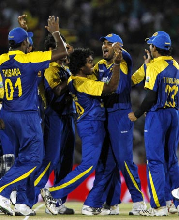 Sri Lanka's players celebrate the dismissal of Virender Sehwag
