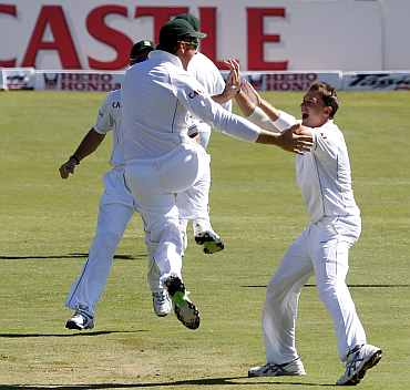 South Africa's Dale Steyn celebrates after picking up India's Virender Sehwag during the first Test match at Centurion