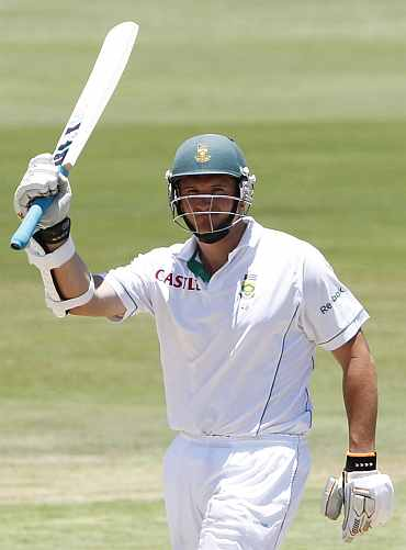 Graeme Smith celebrates after scoring a half-century during the first Test against India at Centurion
