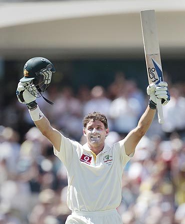 Australia's Michael Hussey celebrates after completing his century