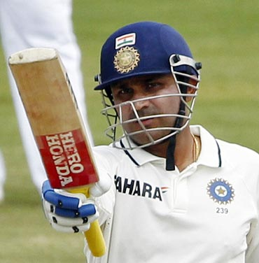 Virender Sehwag celebrates after scoring his half-century