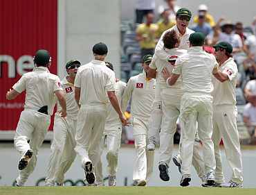 Australian players celebrate after winning the thrid Ashes Test against England in Perth