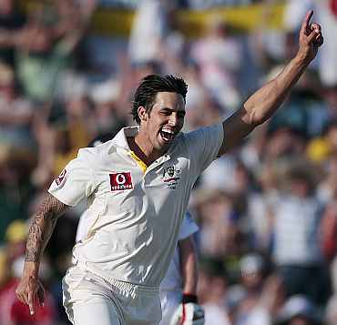 Australia's Mitchell Johnson celebrates after picking up a wicket against England during the third Ashes Test in Perth