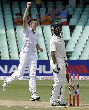 South Africa's Morne Morkel celebrates after dismissing India's Cheteshwar Pujara during a second Test