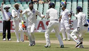 India's Harbhajan Singh celebrates after dismissing South Africa's AB de Villers during the second Test in Durban