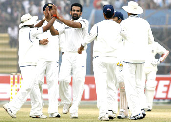 Indian fielders congratulate Zaheer Khan (3rd from left) after dismissing Bangladesh's Imrul Kayes