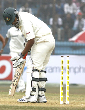 Bangladesh's Tamim Iqbal looks on disappointedly after being bowled by Zaheer Khan