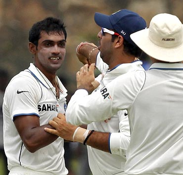 Abhimanyu Mithun (left) is congratulated by team mates after taking the wicket of Tillakaratne Dilshan
