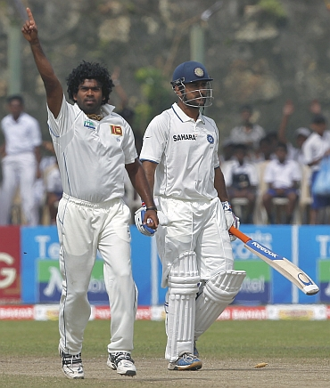 Lasith Malinga celebrates after picking up MS Dhoni