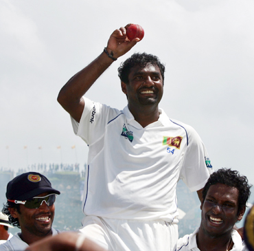 Muralitharan shows ball as team mates carry him on their shoulders in Galle