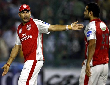 Yuvraj Singh (left) and Irfan Pathan exchange words