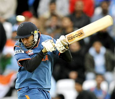 Yuvraj Singh tries to evade a bouncer