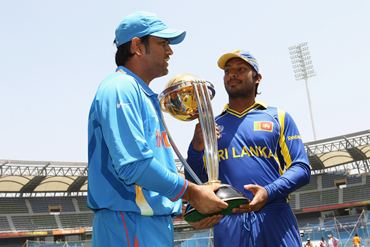 Kumar Sangakkara (R) and MS Dhoni with the World Cup trophy ahead of the final, at the Wankhede stadium