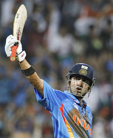 Gautam Gambhir acknowledges the crowd after scoring his half century