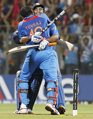 India's Yuvraj Singh hugs captain Mahendra Singh Dhoni after they beat Sri Lanka to win the World Cup final