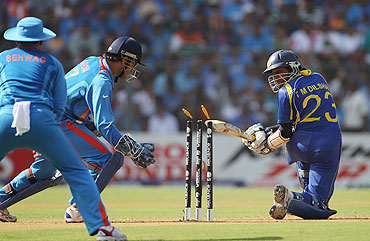 Dilshan is bowled by Harbhajan Singh