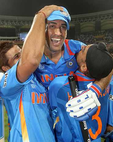 MS Dhoni celebrates after winning the World Cup final