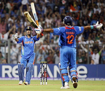 Dhoni and Yuvraj celebrate. India has won the World Cup!