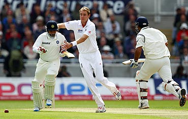 Stuart Broad collides with Amit Mishra as he tries to field the ball