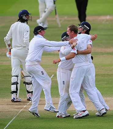 England players celebrate after winning the first Test