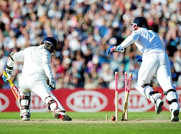 Virender Sehwag is bowled by Graeme Swann as wicketkeeper Matt Prior (right) celebrates