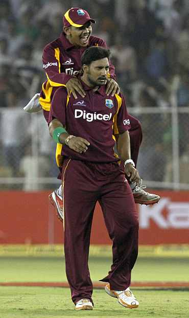 Ravi Rampaul celebrates after winning the match against India