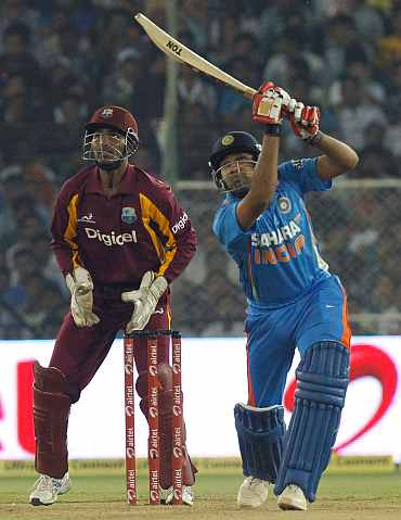 Rohit Sharma hits a six during his knock against West Indies