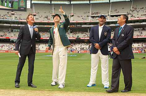 Michael Clarke and Mahendra Singh Dhoni during the toss ahead of the start of the first Test match