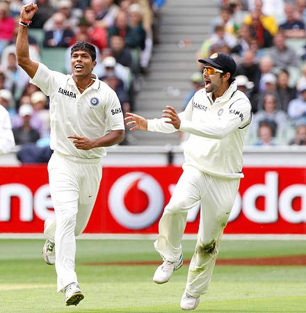 Umesh Yadav (left) celebrates with team-mate Virat Kohli after getting the wicket of Ricky Ponting
