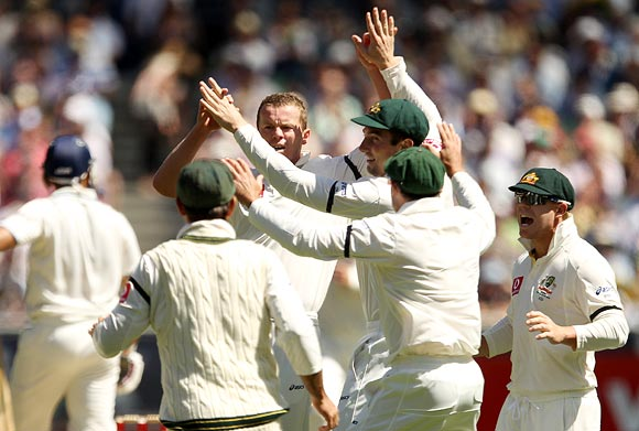 Peter Siddle is congratulated by team-mates after getting the wicket of VVS Laxman