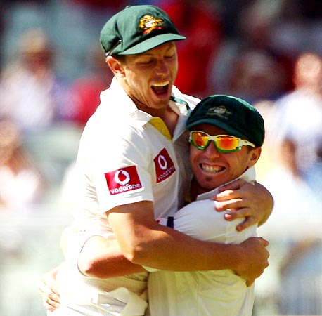 James Pattinson, left, celebrates with Peter Siddle after winning the first Test
