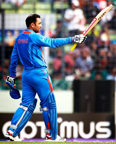 Virender Sehwag celebrates after his completing his century