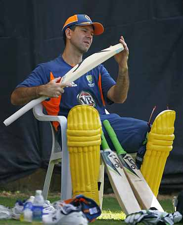 Ricky Ponting checks his bat during a practice session in Ahmedabad