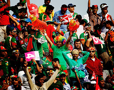 Bangladesh cricket fans soak in the fun during the opening game of the Cricket World Cup between Bangladesh and India at the Shere-e-Bangla National Stadium on Saturday