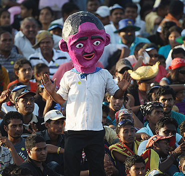 A Sri Lanka fan dances as he cheers his team during their match against Canada