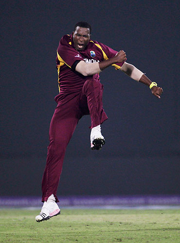 Kieron Pollard of West Indies celebrates the wicket of Graeme Smith