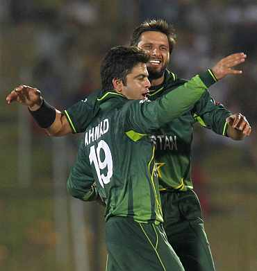 Shahid Afridi celebrates after picking up a wicket