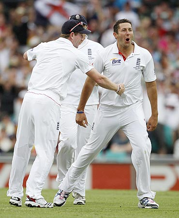 England's Paul Collingwood (left) celebrates with Tim Bresnan after claiming the wicket of Australia's Shane Watson on Monday
