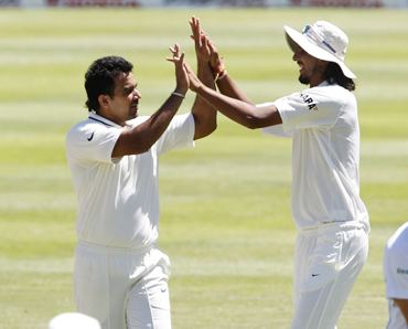 Zaheer and Ishant celebrate the dismissal of Harris