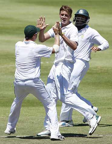 South African players celebrate after taking an Indian wicket