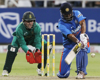 MS Dhoni plays a shot during the third One-dayer against India and South Africa at Newlands