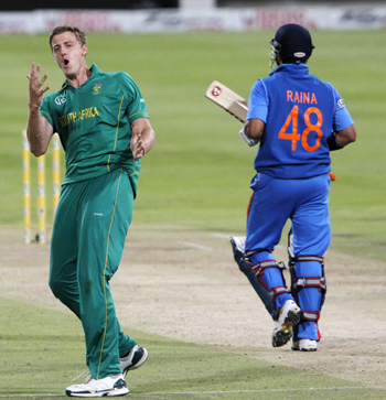 Morne Morkel celebrates after picking up Suresh Raina during the thrid One-dayer at Newlands