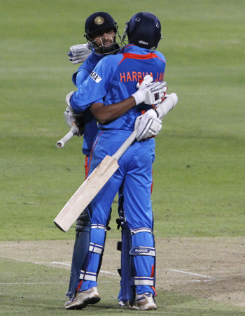 India's Harbhajan Singh and Ashish Nehra celebrate after winning the third ODI against South Africa