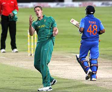 South Africa's Morne Morkel celebrates after picking up India's Suresh Raina