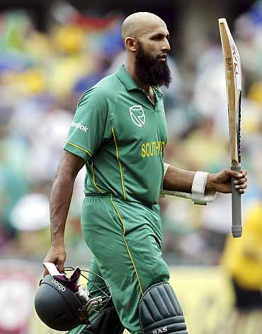 Hashim Amla celebrates after hitting a century in the fifth and final One-dayer against India